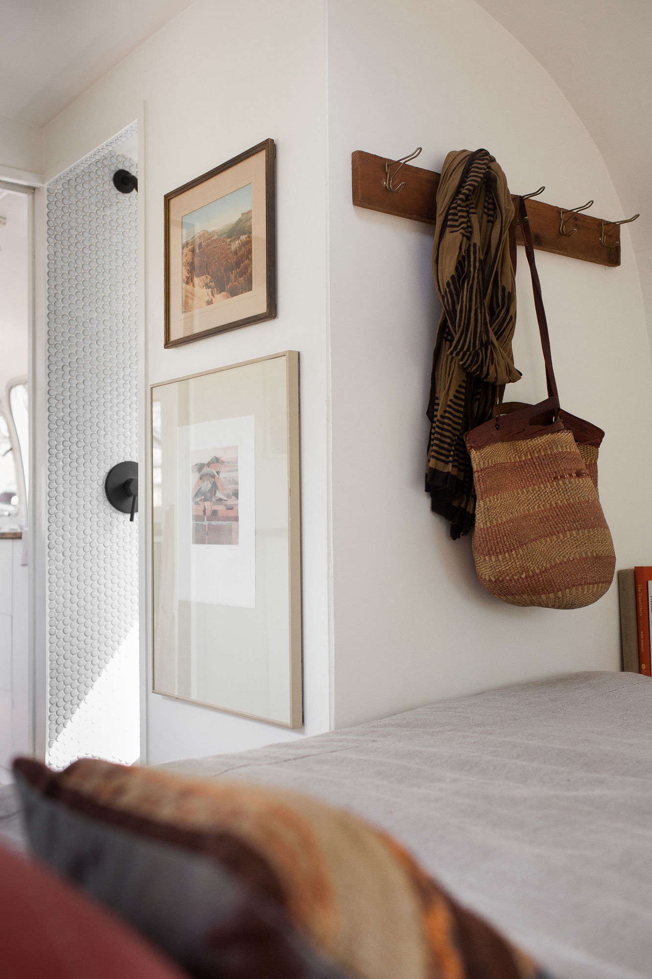 A Row Of Vintage Hooks Provides More Storage In The Bedroom.