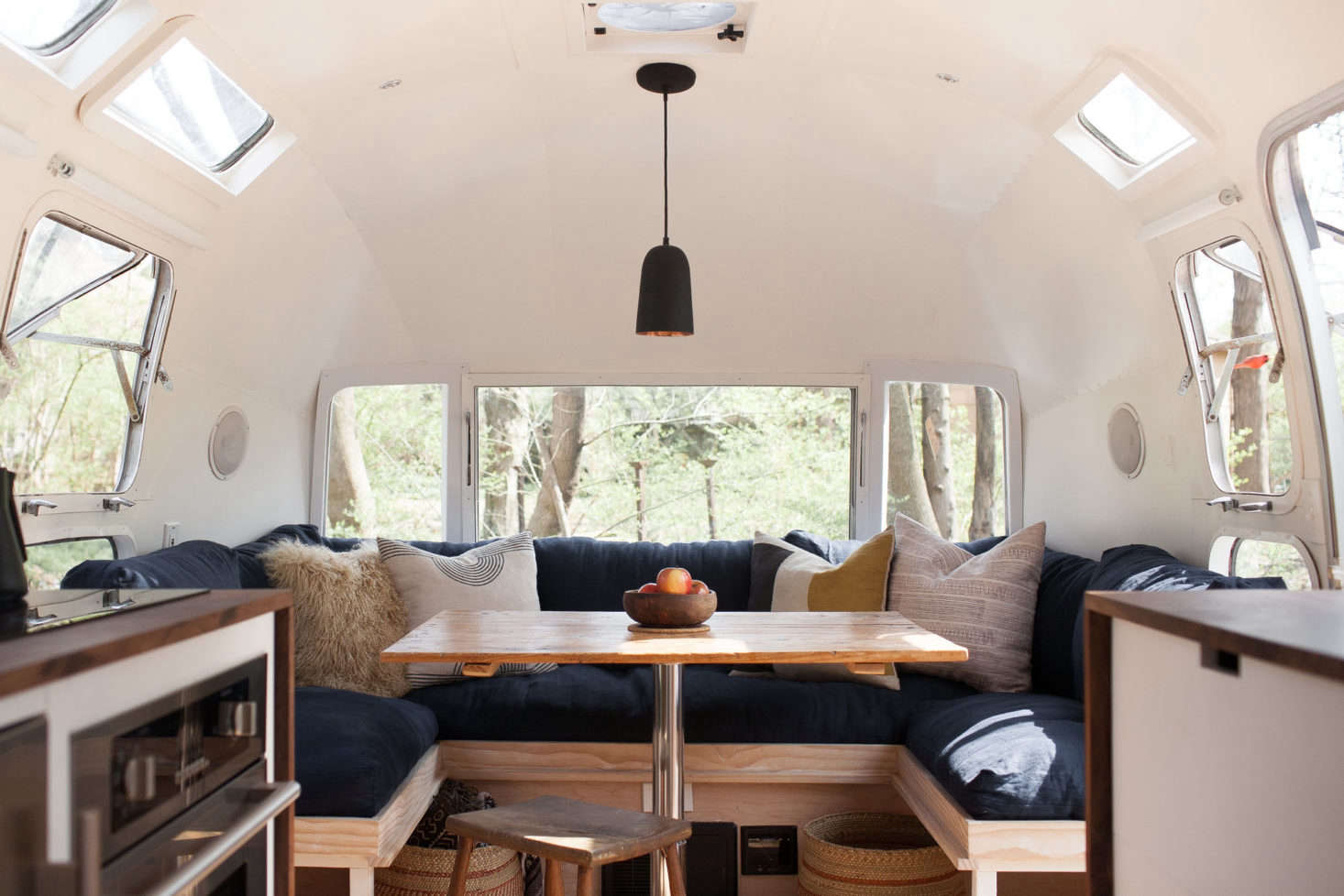 Superbe The Dining Area Of Modern Caravanu0027s Vintage Airstream Features A Custom  Table Made From Salvaged Boards