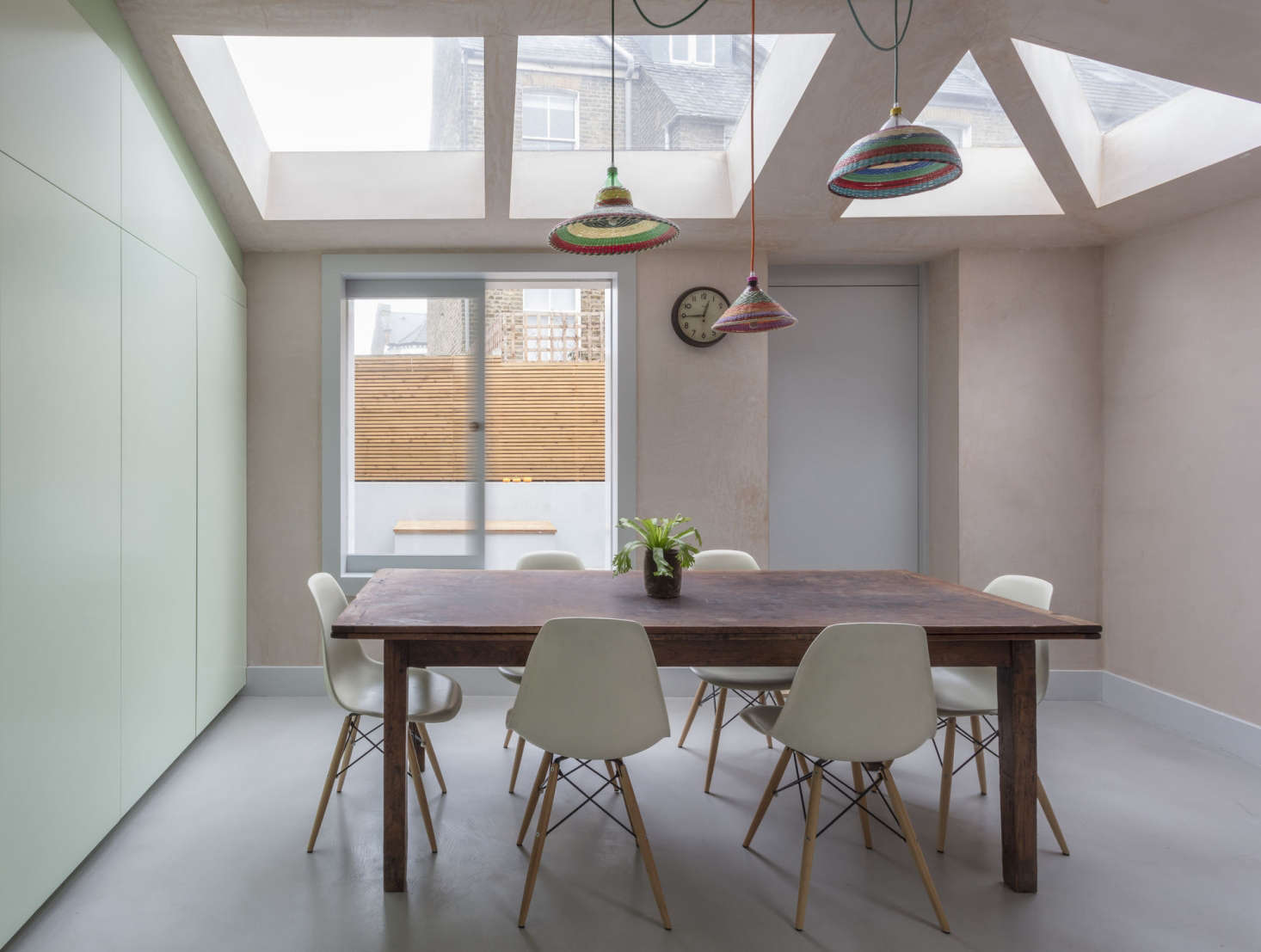 """Pale pink was selected for the walls during the course of construction: """"The plaster we use comes in a pink tone, then it usually gets skimmed and painted. But when we saw the work in progress, we all fell in love with the depth and color, so it was easy to convince our clients to leave it exposed,"""" Dumciute tells us. """"Pink inside and out was a happy coincidence, really."""""""