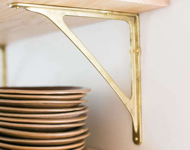 The solid, uncoated brass Shelf Bracket is $240.