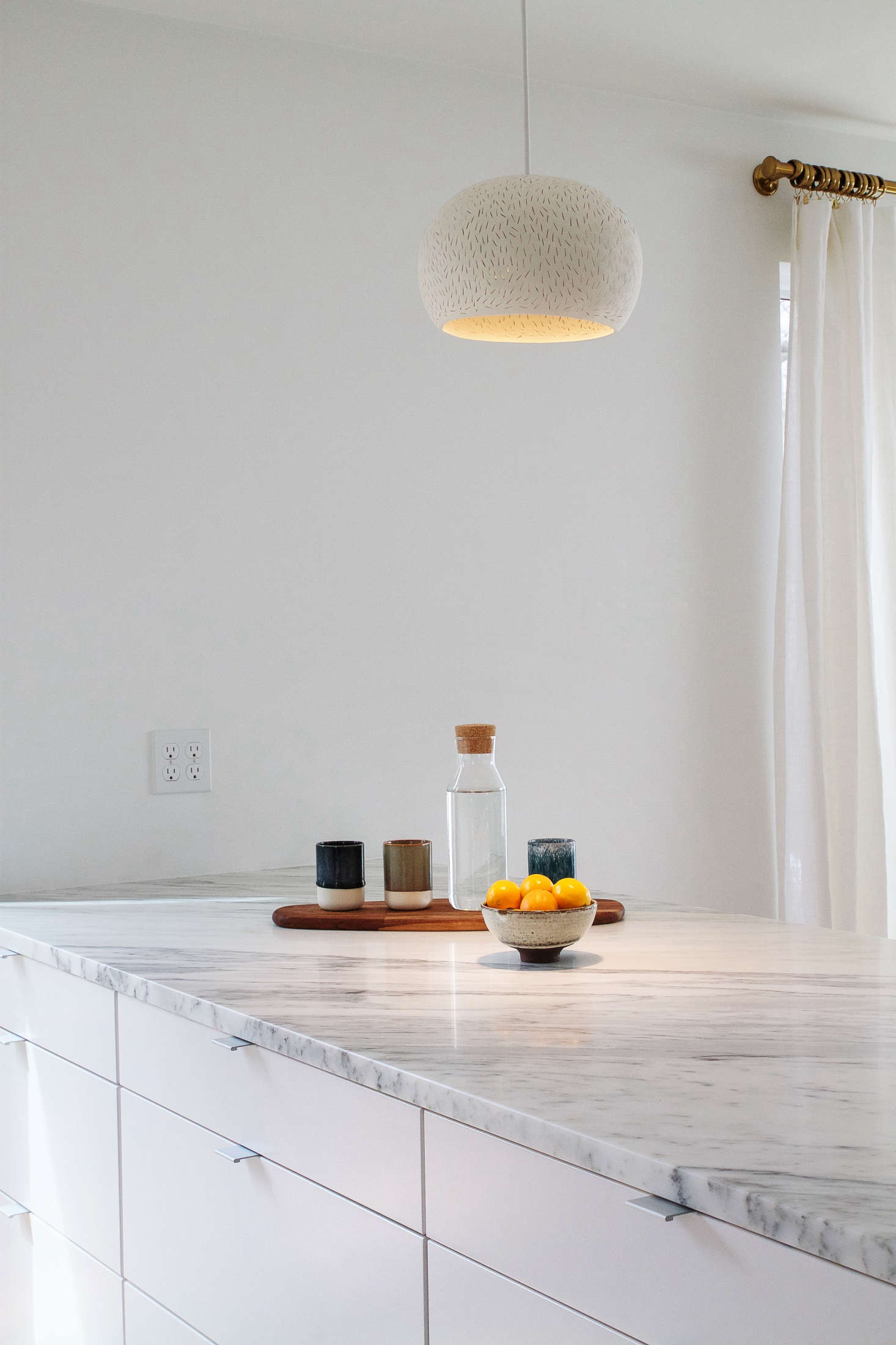 Dark, Demode Kitchen Transformed Into Bright, White