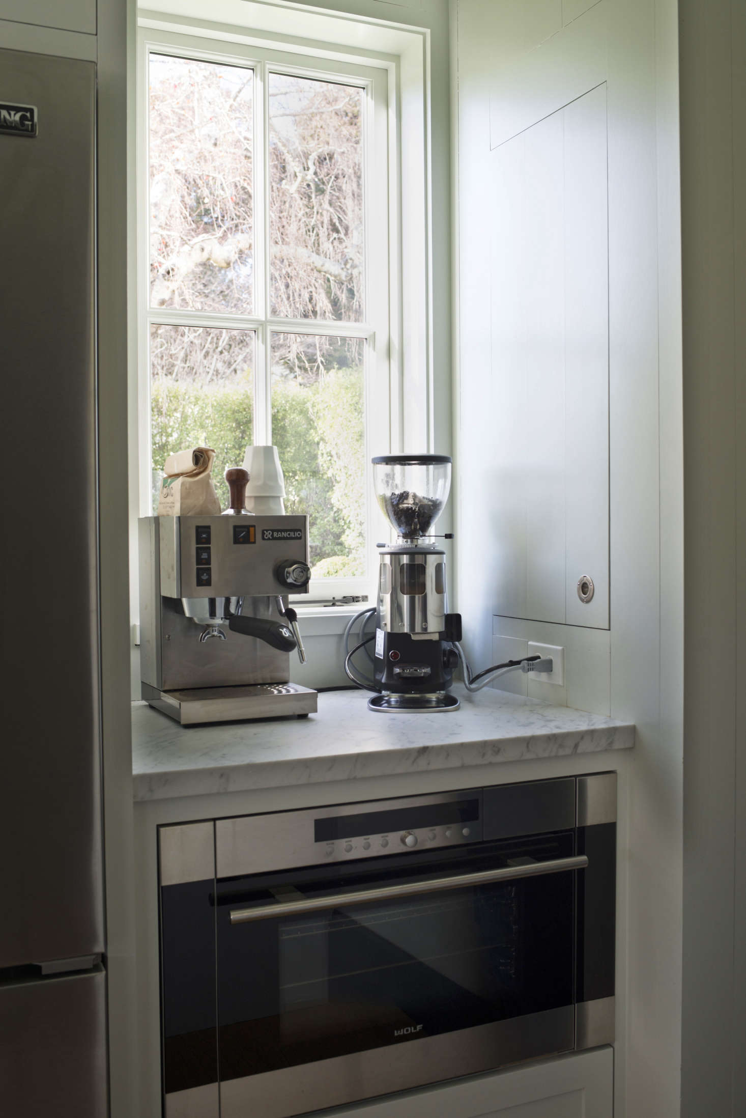 A Rancilio Silvia Espresso Machine Stocks The Coffee Nook Next To The  Refrigerator. The Broom