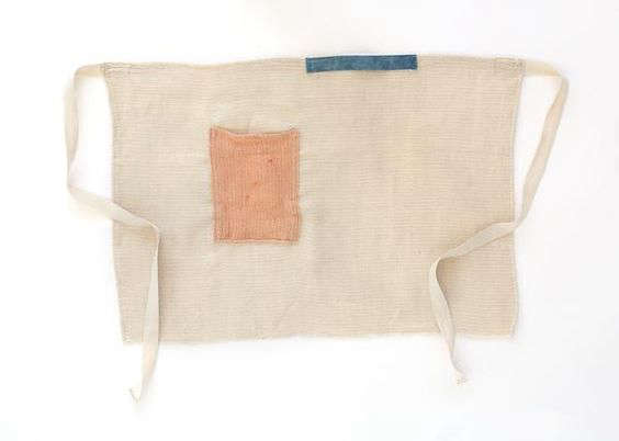 Sin's Color-Block Half Apron features a towel loop and side pocket; $98.