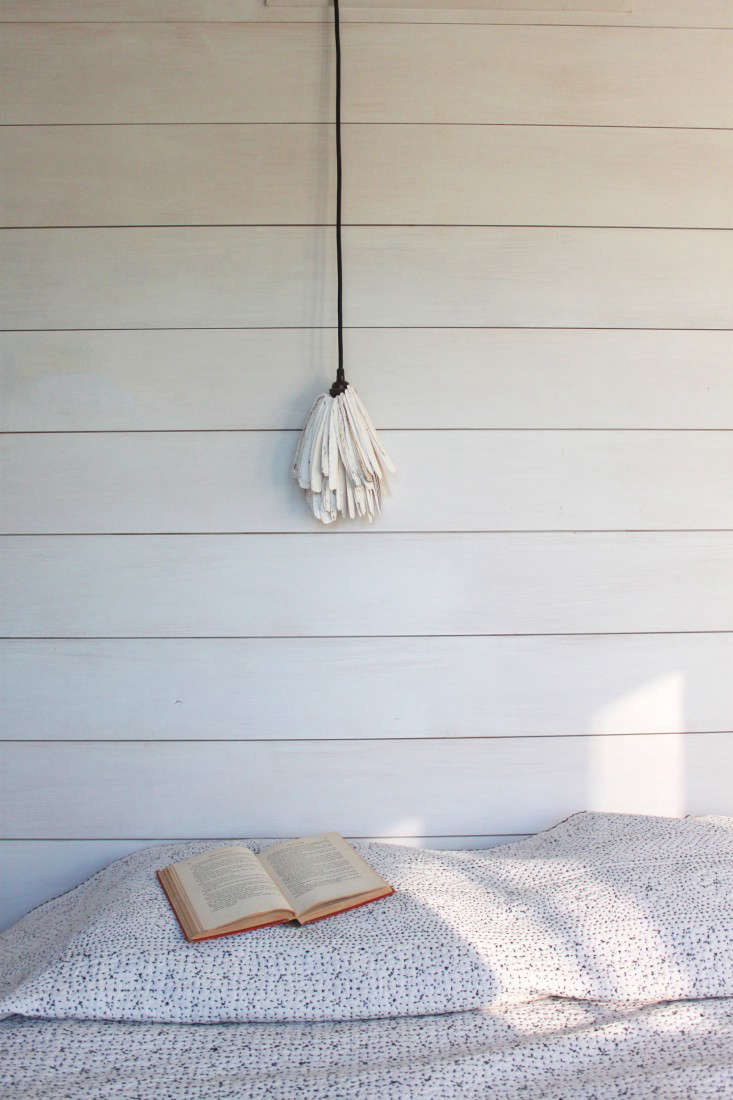 A detail of shiplap in Sheila Bonnell's guest room; photograph by Matthew Williams for Remodelista, as seen in Remodeling src=