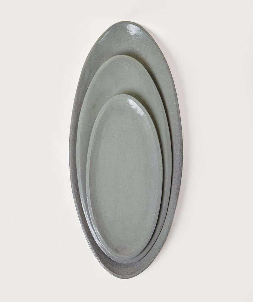 A set of Assisi Oval Platters in Sage Green, $300.