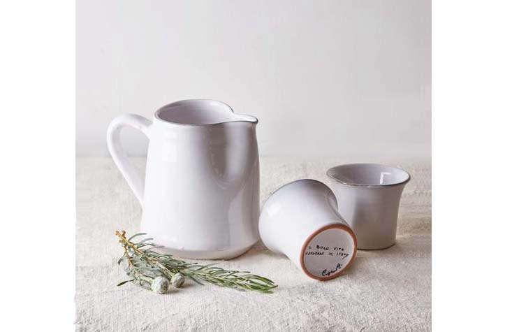 The terracotta Bevagna One Litre Pitcher is glazed in white with a green rim; $70.