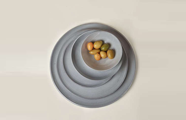 A stack of Assisi plates in pale blue-grey.