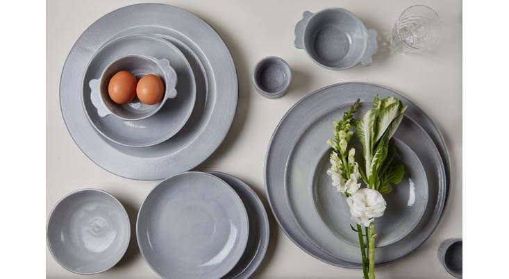 Muted blue-gray tableware. The charmingAssisi Small Bowl with Handles (top left) is $65.
