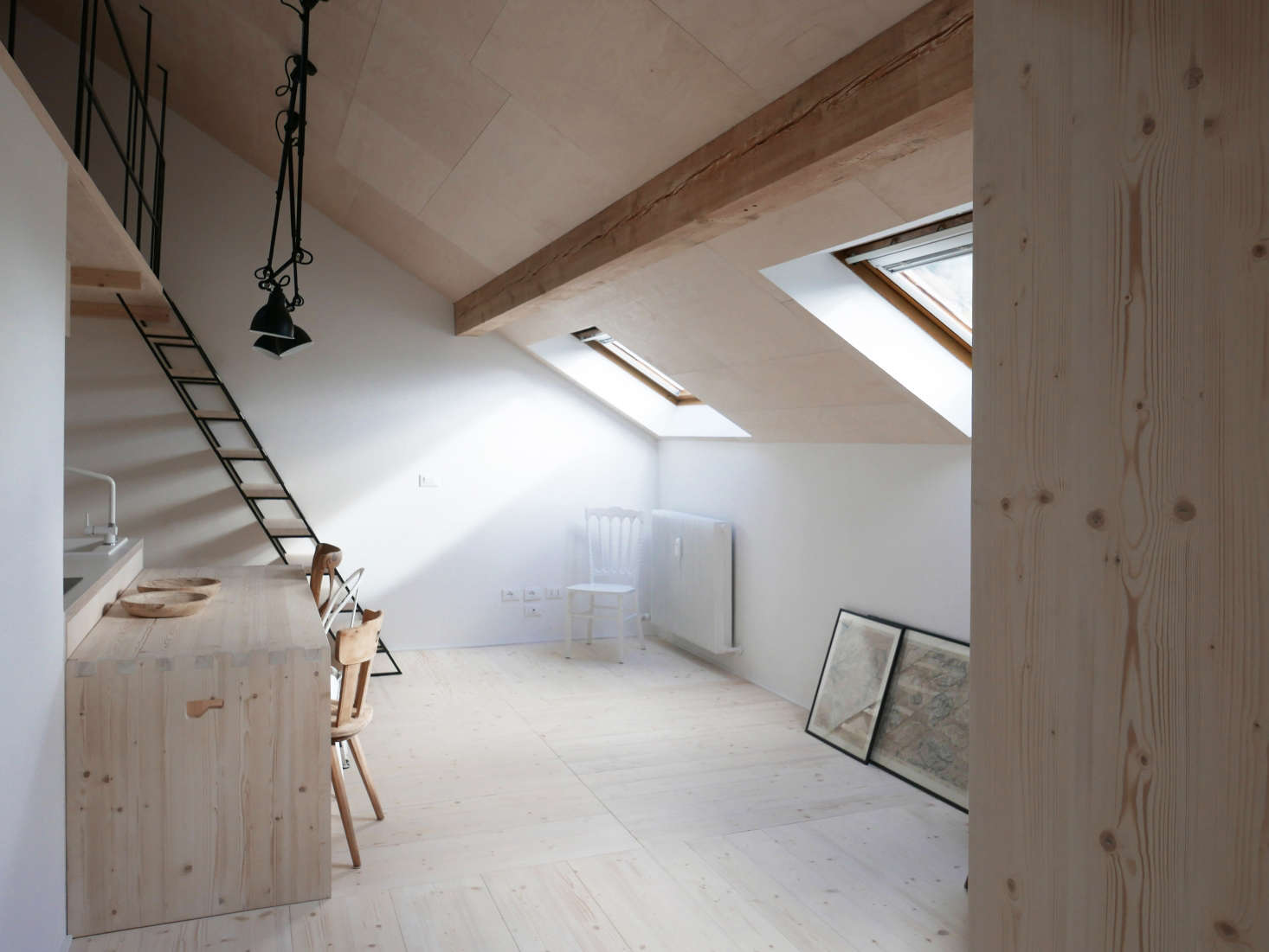 InA Light-Filled Chalet in the Italian Alps, Updated for a Young Skier, plywood adds detail to the steeply pitched ceiling.