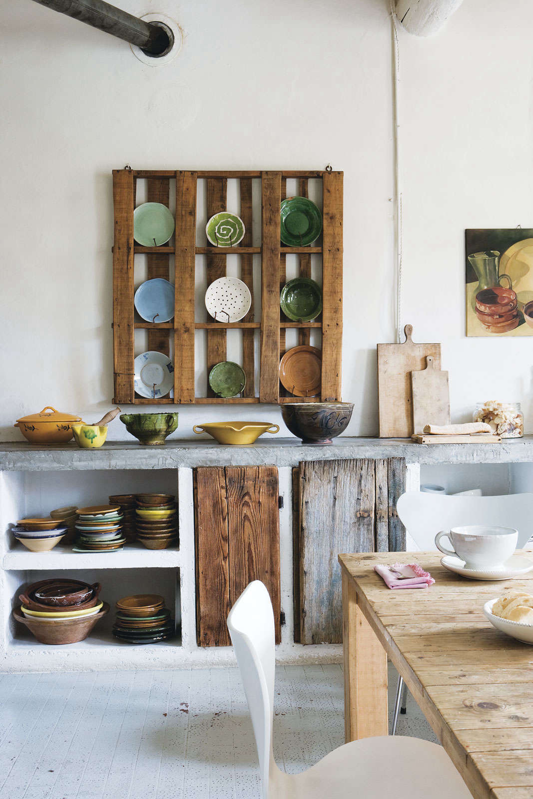 German designer Katrin Arens own kitchen in Italy from Slow Design: Pallet as Plate Rack by Katrin Arens.