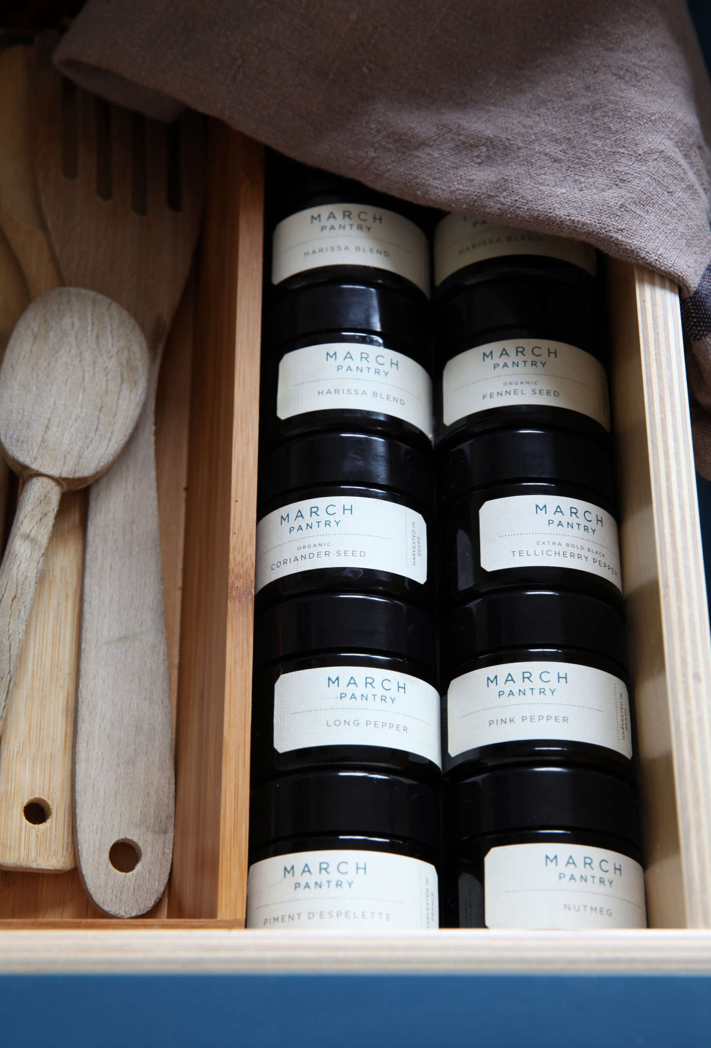 In a drawer by the stove, a variety of spices from March Pantry,starting at $src=