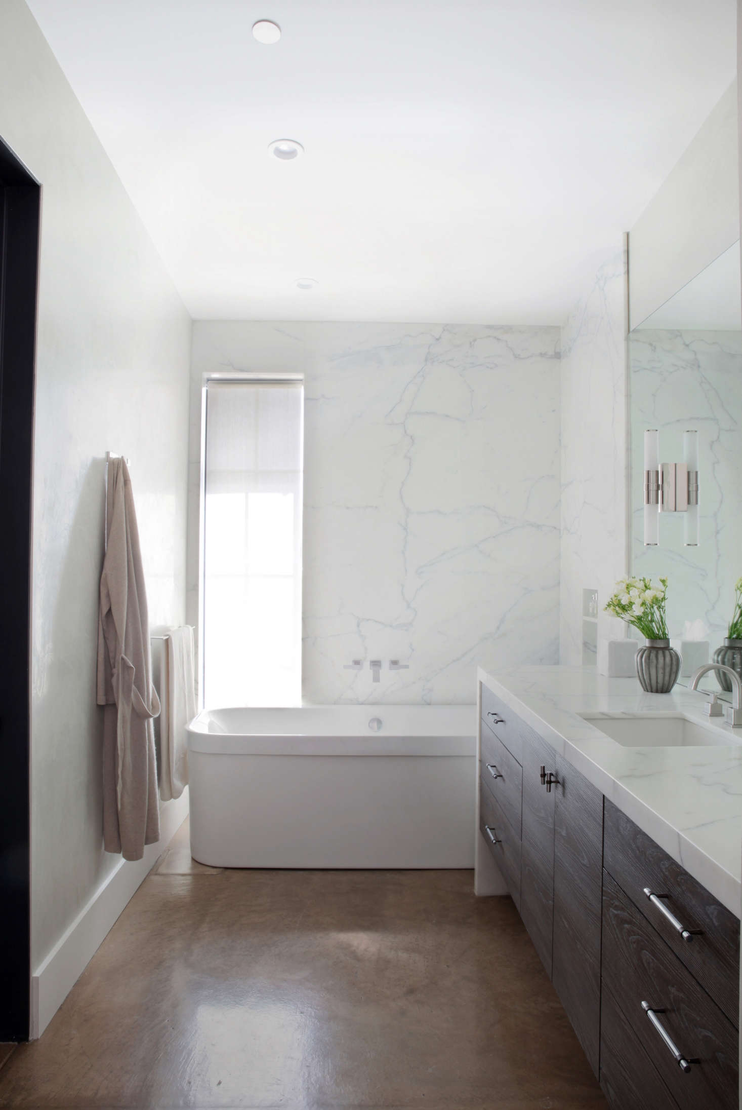 The walls in the master bathroom are waxed Venetian plaster by Willem Racké Studio in San Francisco. The countertop and shower surround is Calacatta Oro.
