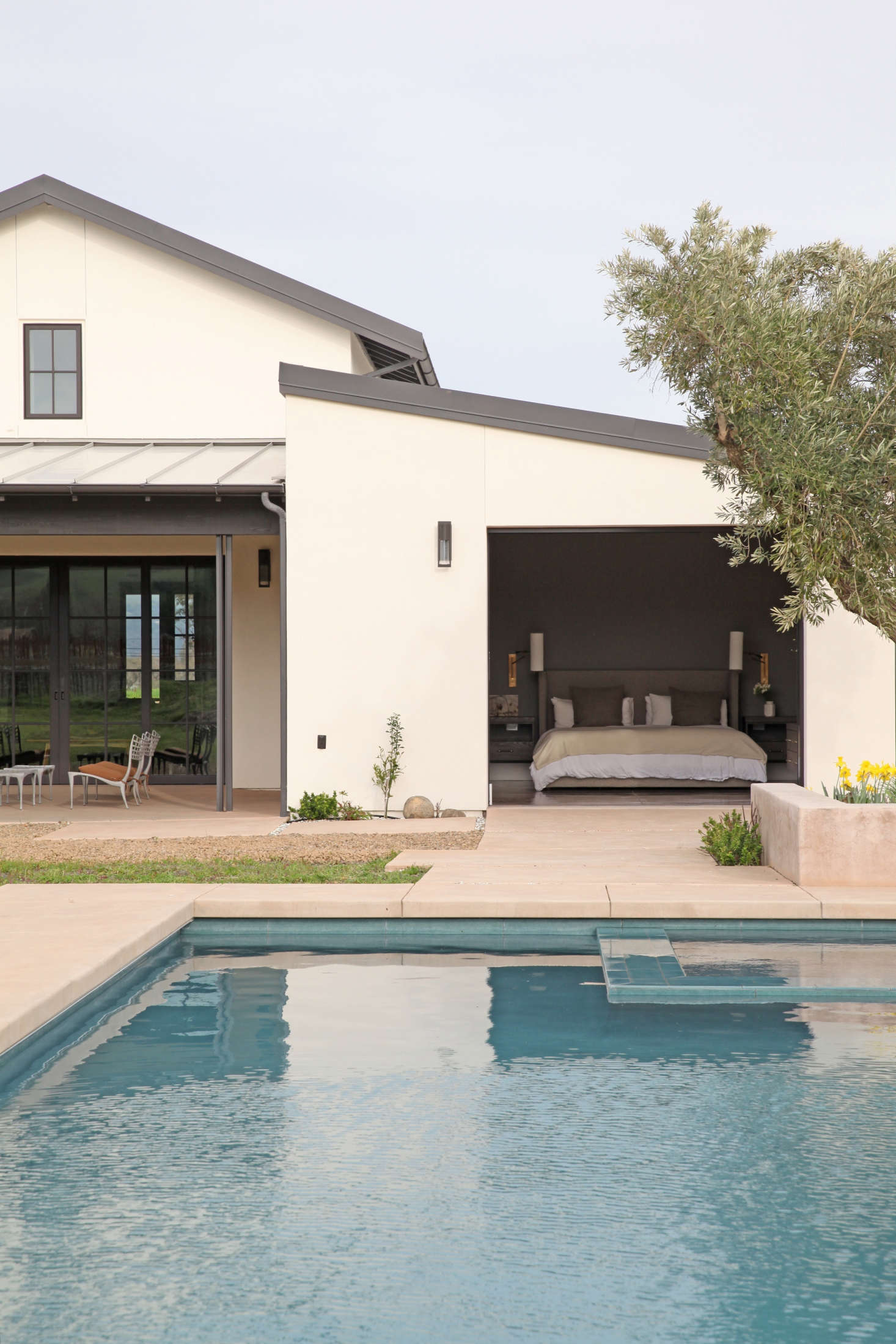 Though the landscape is still a work in progress, the pool and hot tub are ready for use. The couple&#8