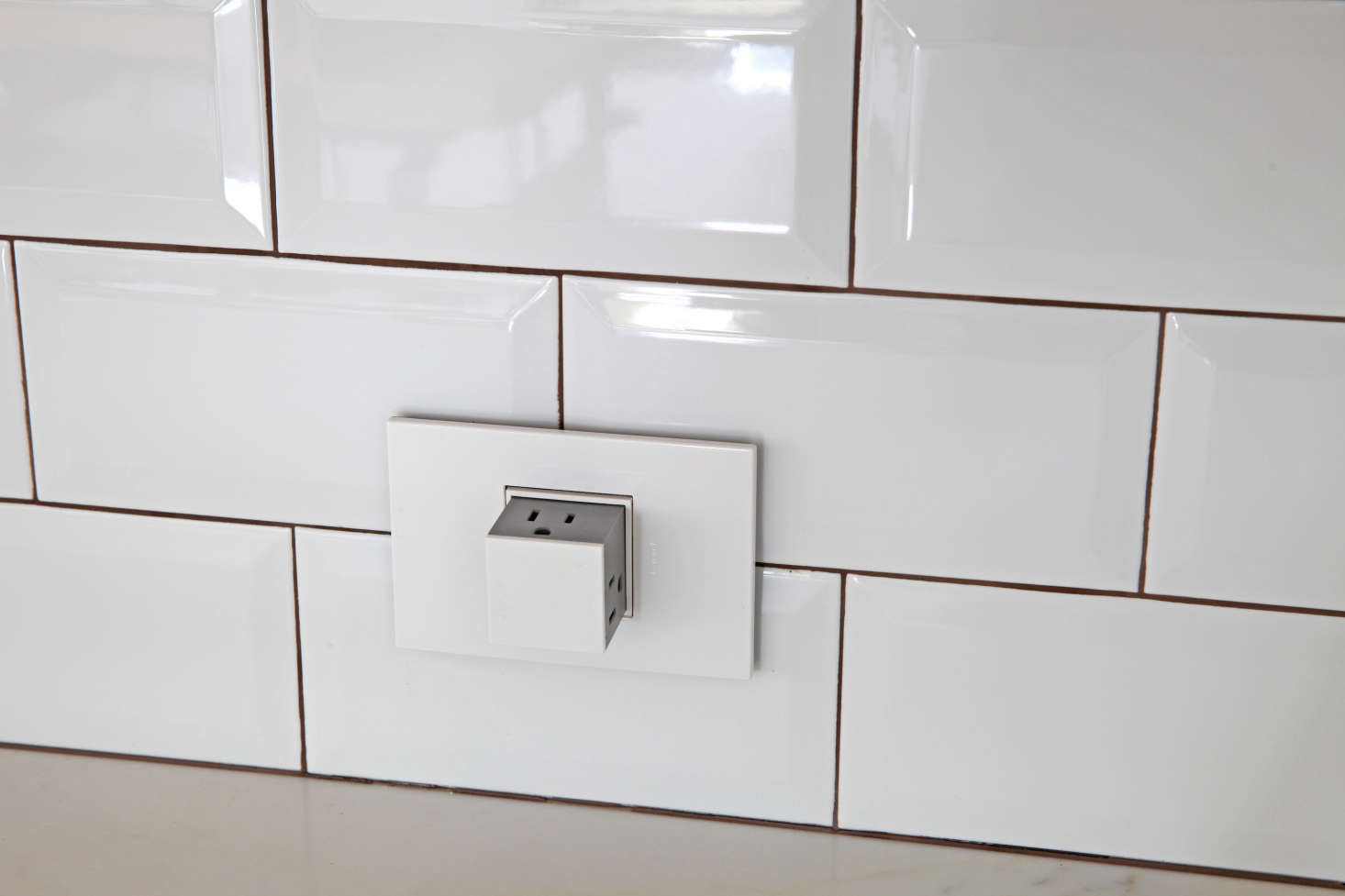 Pop-up outlets, used throughout the kitchen, disappear when not in use.