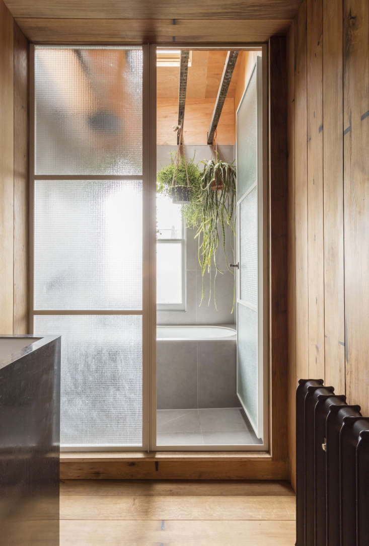 A Japanese Style Two Room Bath Filled With Hanging Plants