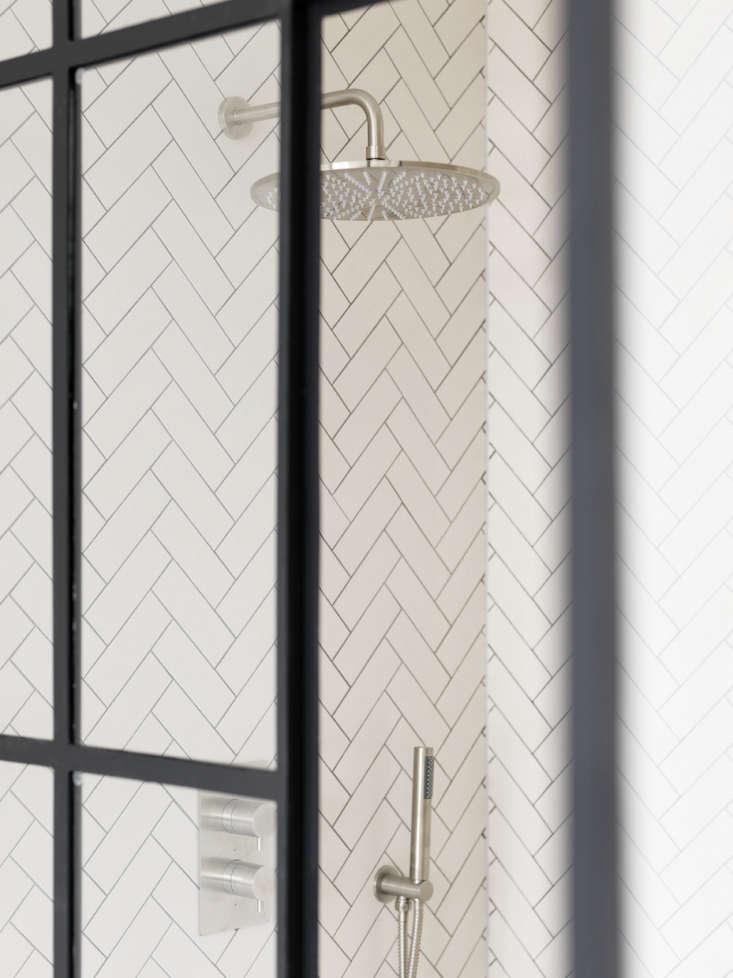 Herringbone Tile And Rain Shower Head In A Shower Detail In A Design By  Studio Maclean