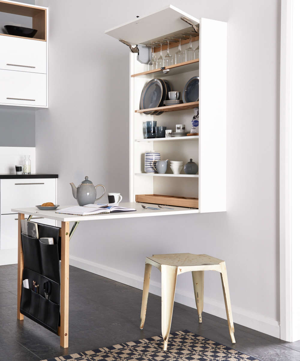 Concealed dining and storage: TheTable Plusfrom UK-based Magnet Kitchens folds against the wall when not in use. See also Tricks for Maximizing Space in a Tiny Kitchen, Urban Edition.