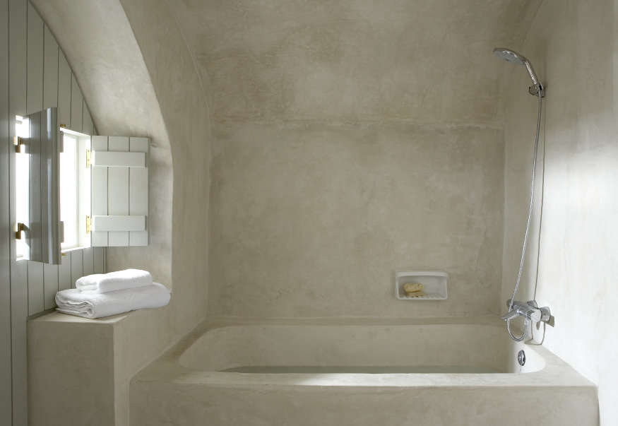 A tadelakt bath at Villa Fabrica's Milos House, one of a compound of vacation rentals designed by architect Yannis Kaklamanis on the Greek island of Santorini.