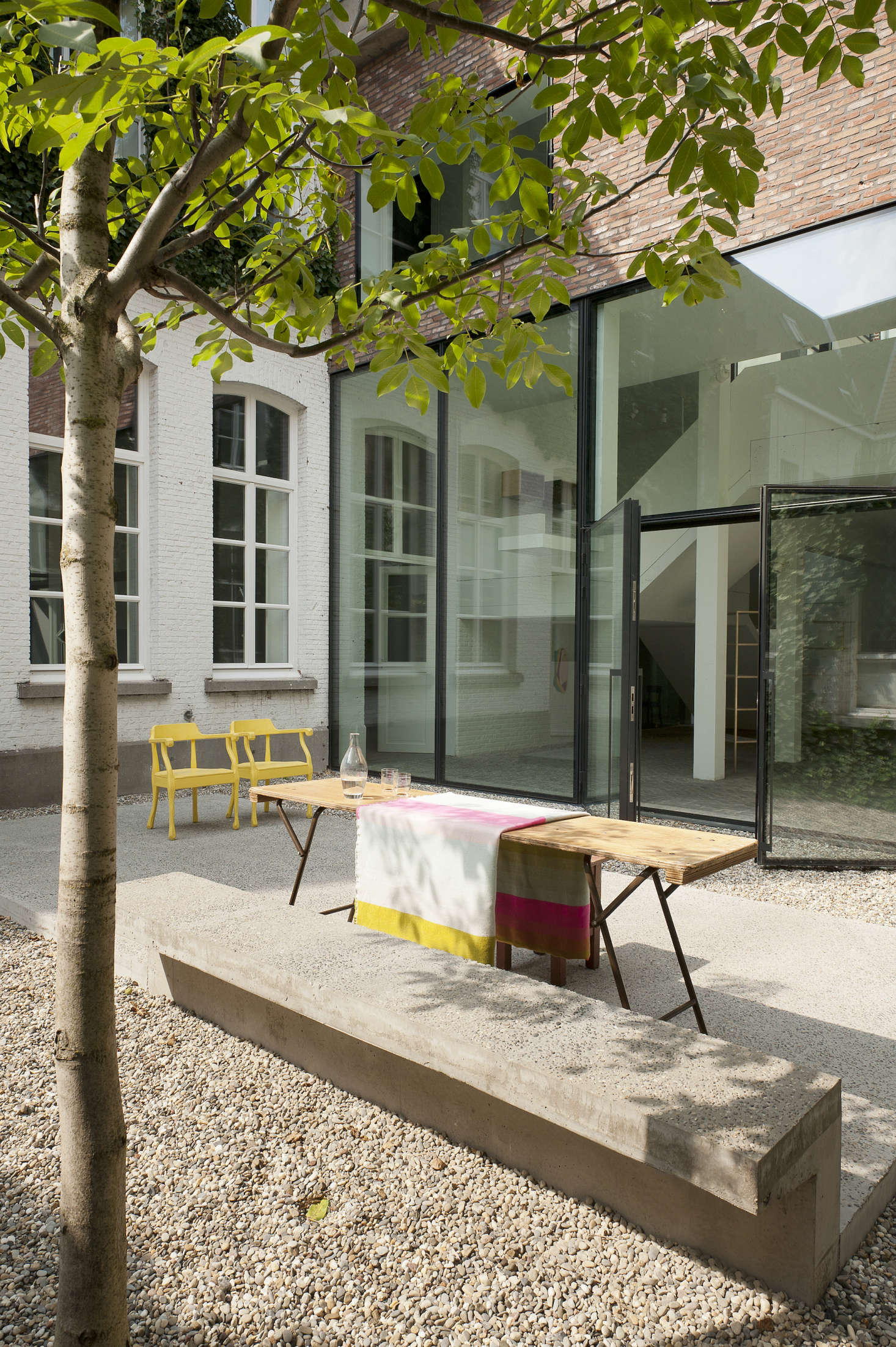 A cement bench is built into the concrete platform island in the courtyard.