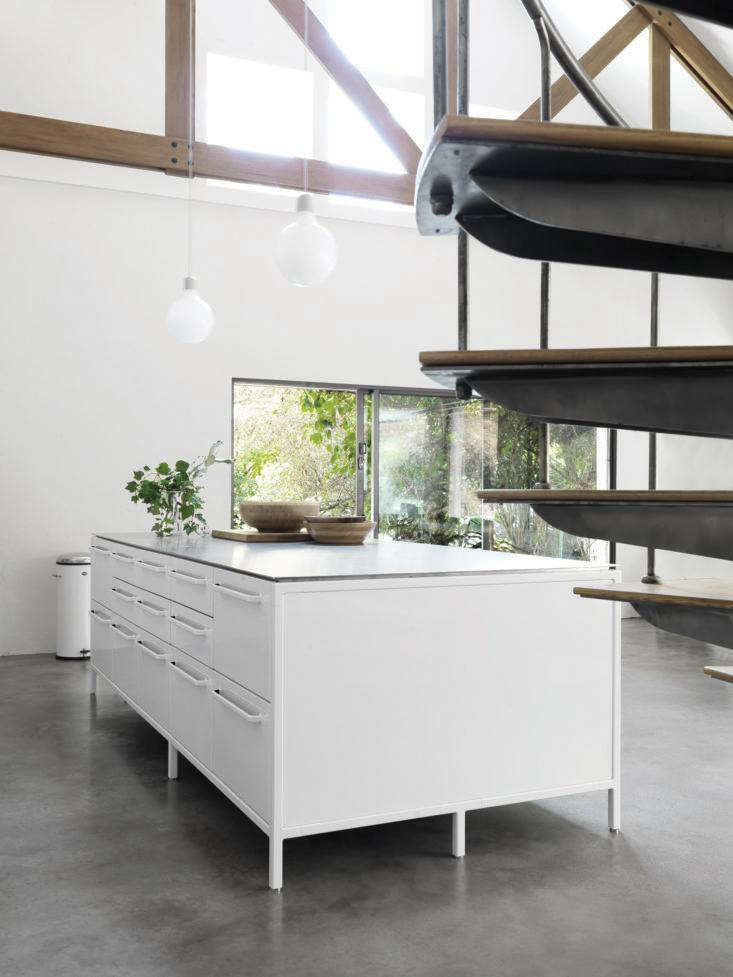 The Vipp island is 50 inches deep and ranges from 50 to 9 inches long, depending on the number of units used. A stovetop and sink can also be incorporated into the steel worktop. The small drawers are fitted with silicone cutlery inserts and larger drawers have protective silicone mats.