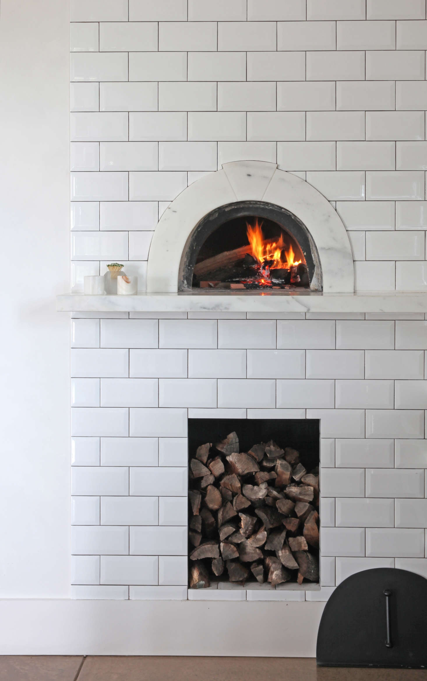 The pizza oven is from Wildwood Ovens in Los Angeles, and the marble surround with keystone detail was designed by Belinda. The pair stores chopped almond wood beneath the pizza oven; Gail ordersit by the cord from a Bay Area company that supplies local restaurants.