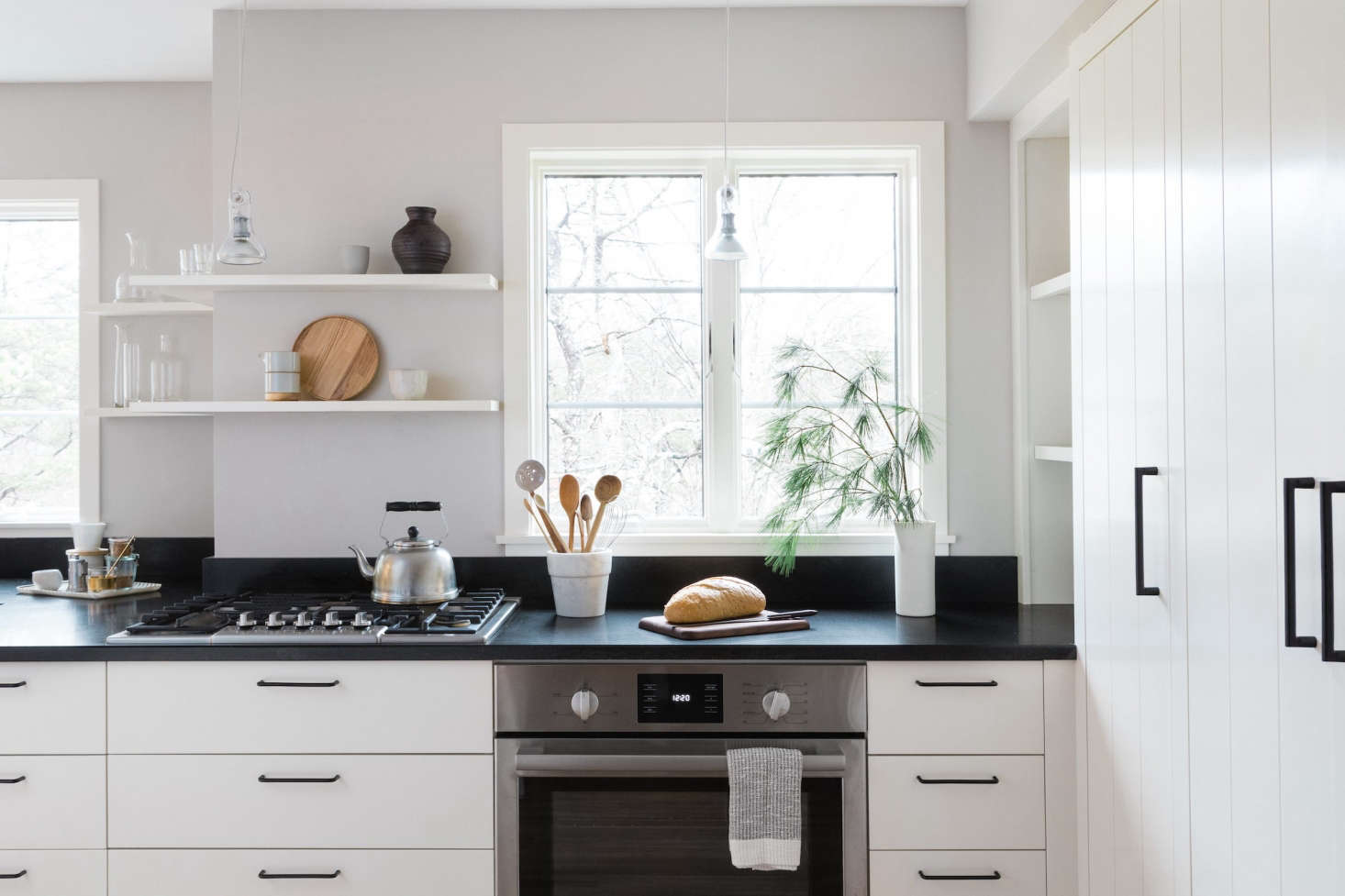 In this recently remodeled New England kitchen, the homeowner paired a Bosch gas cooktop with a Bosch wall oven. Getthe whole look in A Japanese-Inflected Kitchen with Bosch Home Appliances.