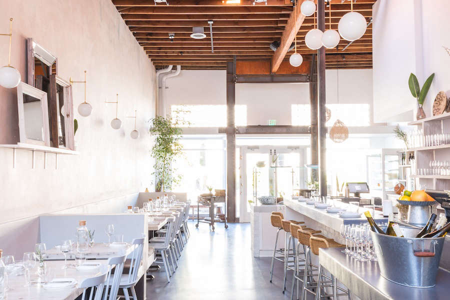 """The concrete floor and counters are a nod to Weekends' time in Paris:""""We had a concrete floor in our kitchen,"""" Messerli says."""