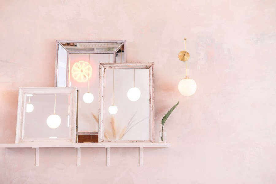 """Vintage mirrors, inspired by a design detail in Weekends' """"favorite little pizza place in London."""""""