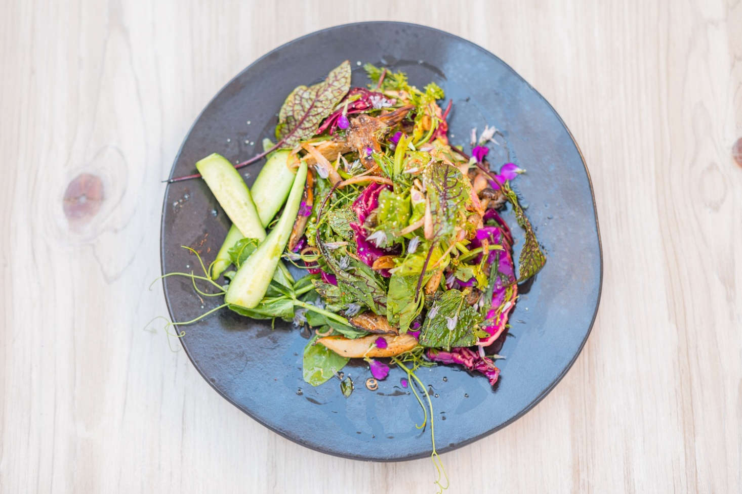 """""""We're big into color and flavor; we're not into rules,"""" Sperling and Fiffer say on their website. On the ever-changing menuare bowls and salads with garden-fresh ingredients like charred leeks, pea tendrils, and cilantro flowers. The duo selected the tableware themselves."""