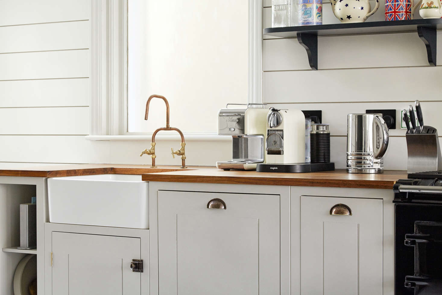 The Butler Sink, Iroko Countertop, And Patinated Brass Pulls Are Also  British Standard Components