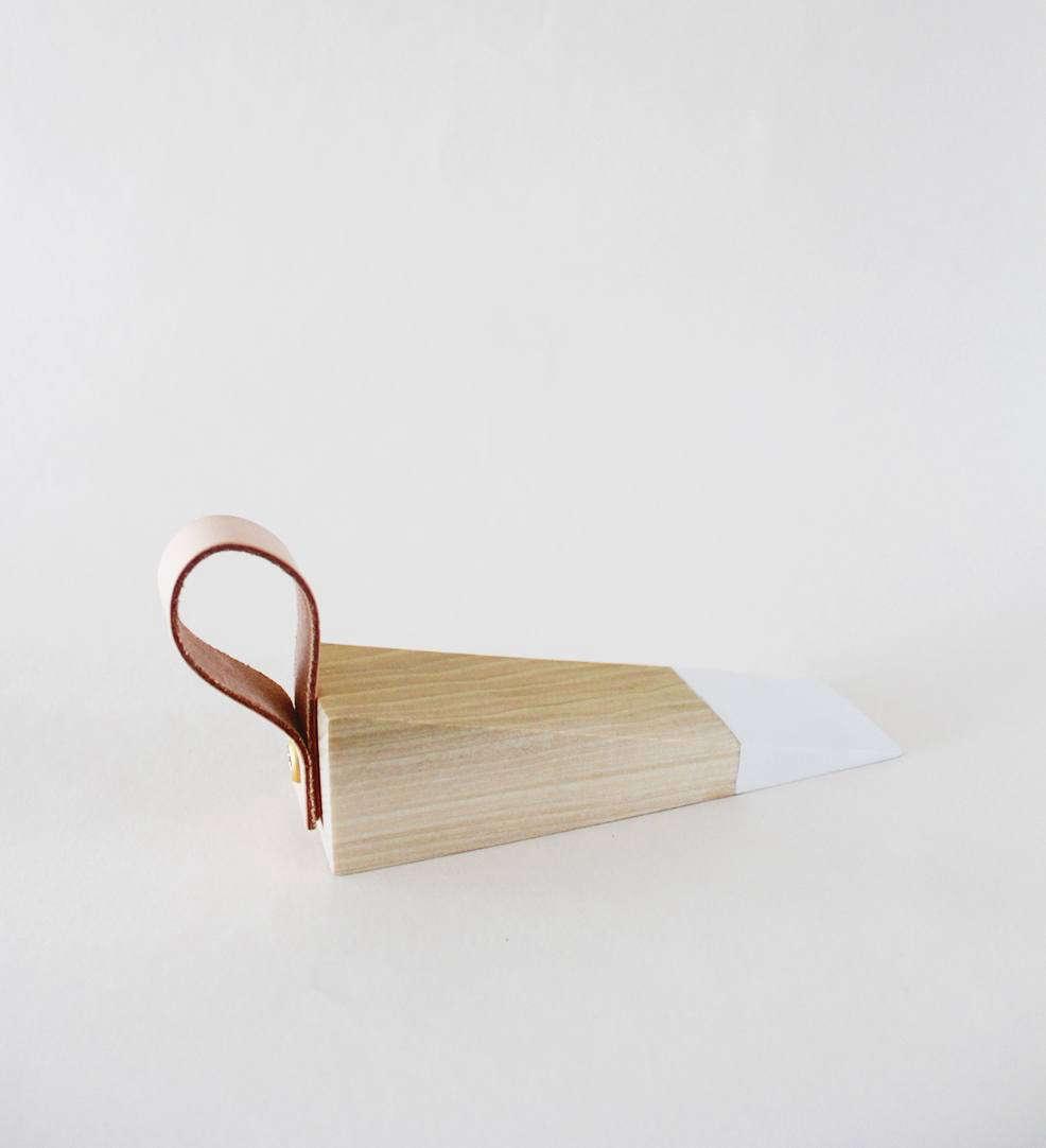 DIY: A Leather-Detailed Wooden Doorstop - Remodelista