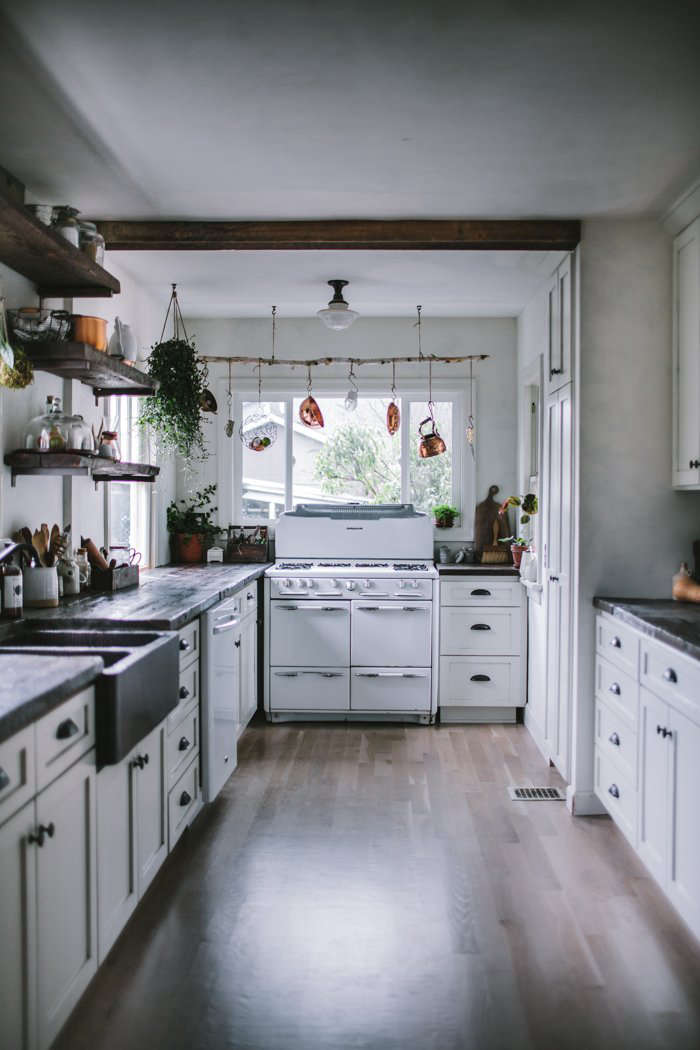 In remodeling her Portland, Oregon, kitchen, blogger Eva Kosmas Floresfound a vintage 1950s Roper gas range on Craigslist for $375, and had the kitchen reconfigured with a gas line. Read more atA Food Blogger's Rustic DIY Renovation in Portland, OR, Dark and Moody Edition.