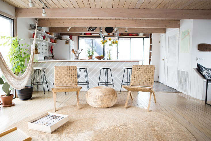 Natural fiber rugs, like this one in the houseboat home of Fredericks & Mae foundersGabe Cohen and Jolie Signorile, not only reflect the casual vibe of the coast but also are excellent sand traps. SeeRehab Diary: The Ultimate Houseboat in NYC.Photograph byDouglas Lyle Thompson.