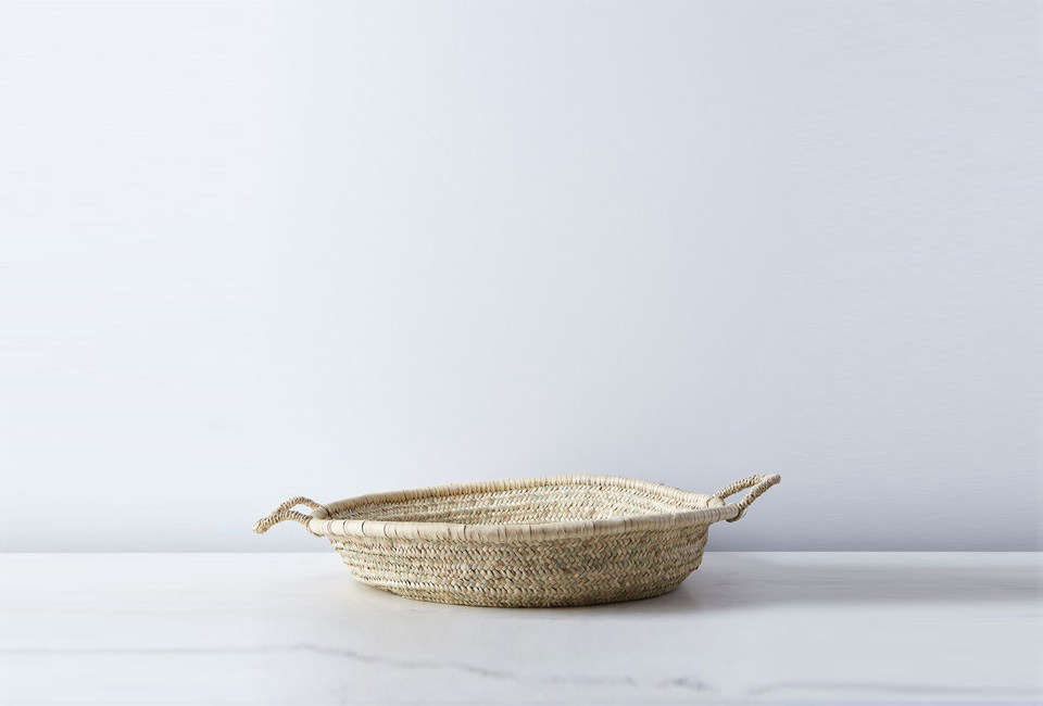 The Handmade Shallow Moroccan Basket is made of seagrass in Marrakech, Morocco; $98 at Food 5