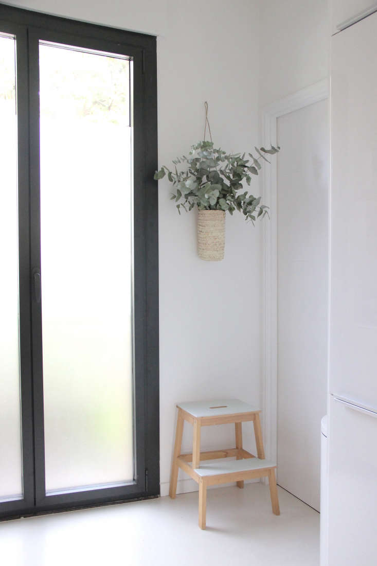 a designer s own scandi style ikea hack galley kitchen in the eucalyptus in hanging straw vase and glass doors in designer ilaria fatone s ground floor apartment