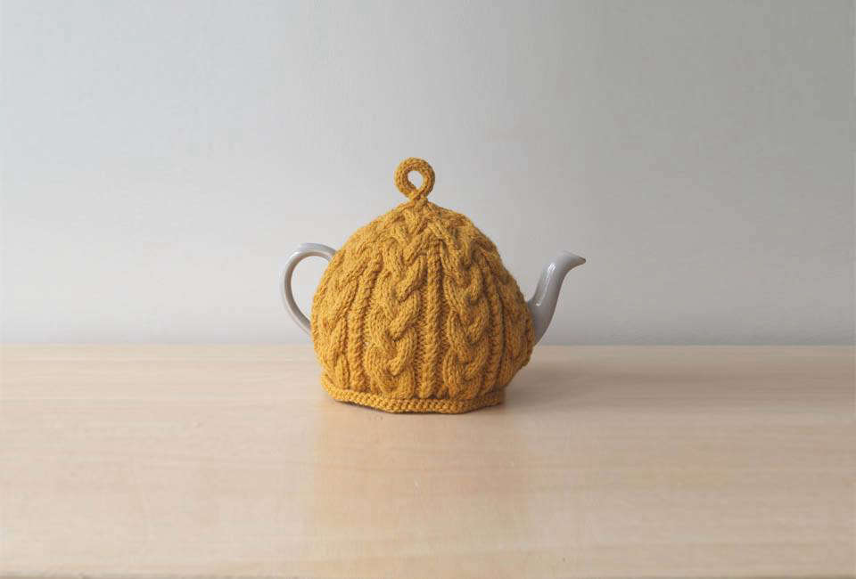 A Golden Yellow Knitted Tea Cosy is available from Lindy Knits, a seller on Etsy, for $26.11.