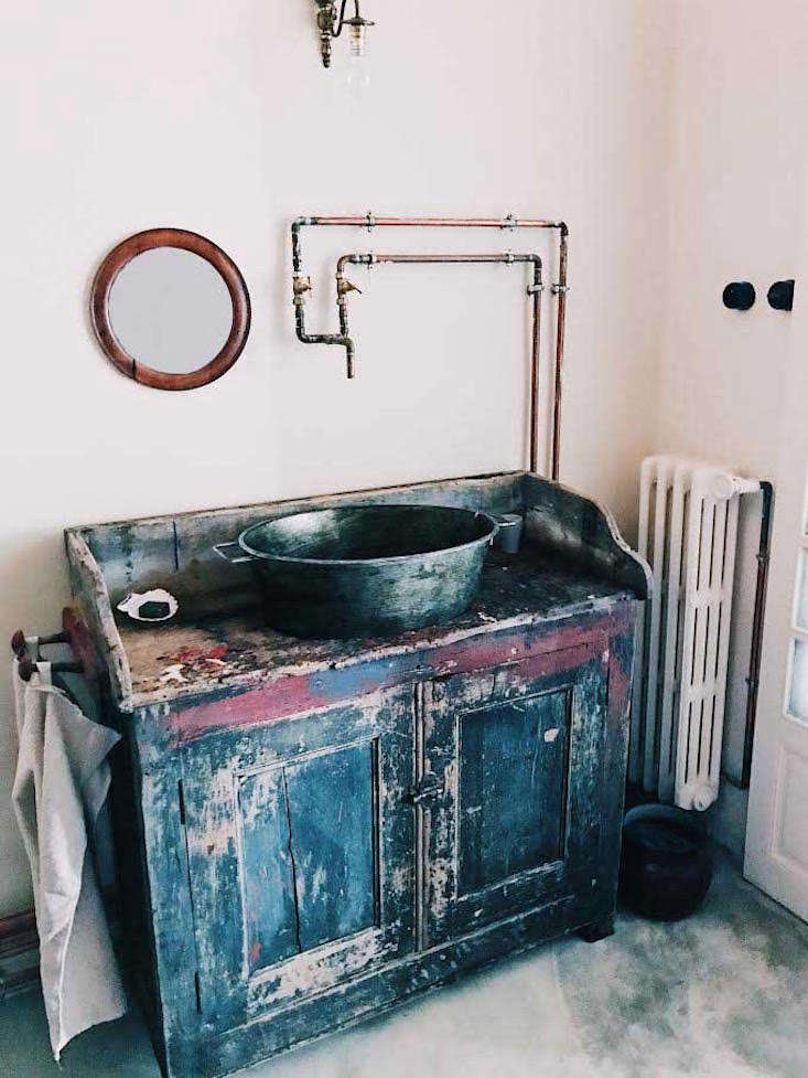 The washing-up setup; the DIY faucets are made from hardware store plumbing components (see Trend Alert: 10 DIY Faucets Made from Plumbing Parts).