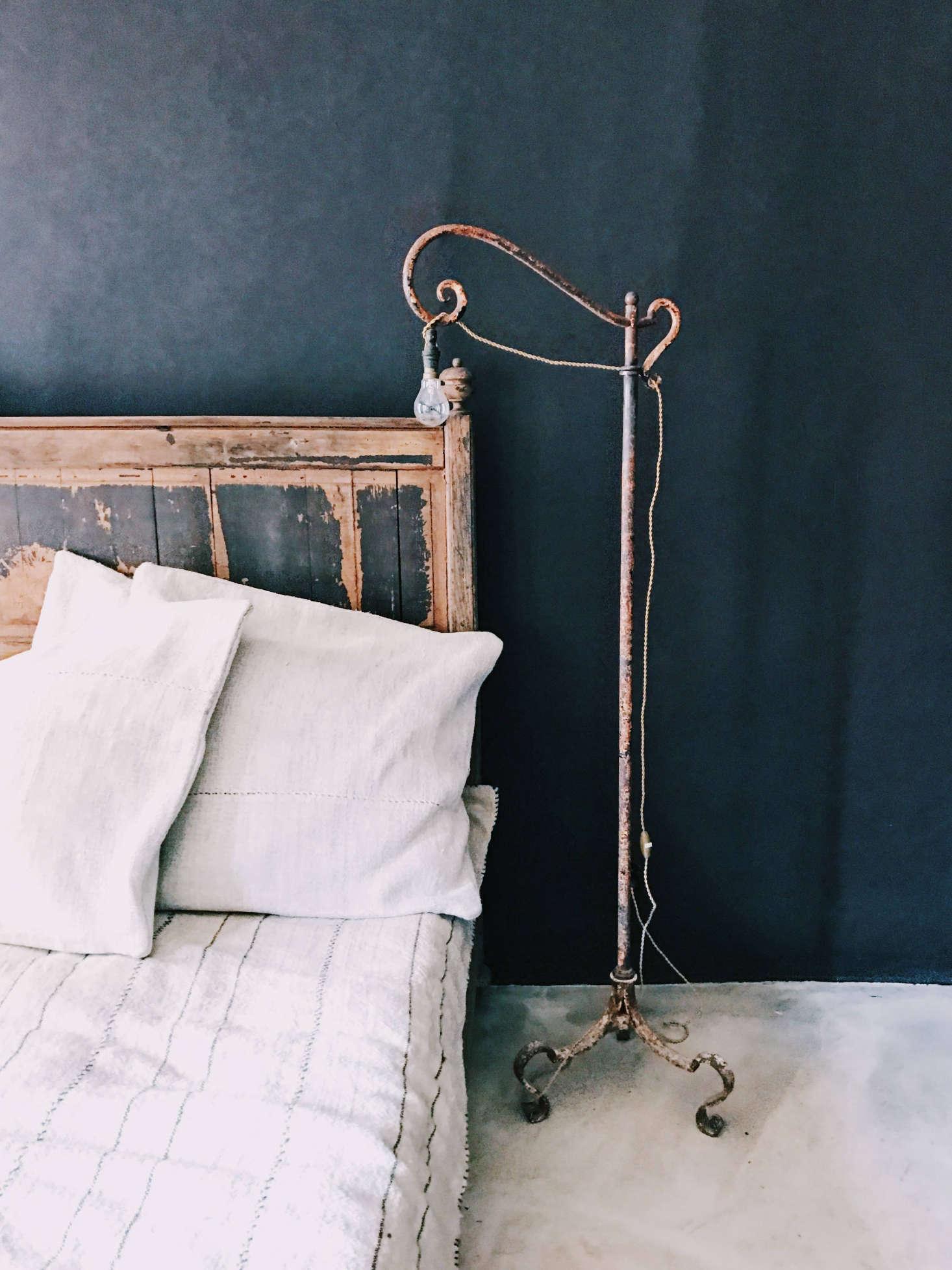 A vintage lamp provides bedside illumination.