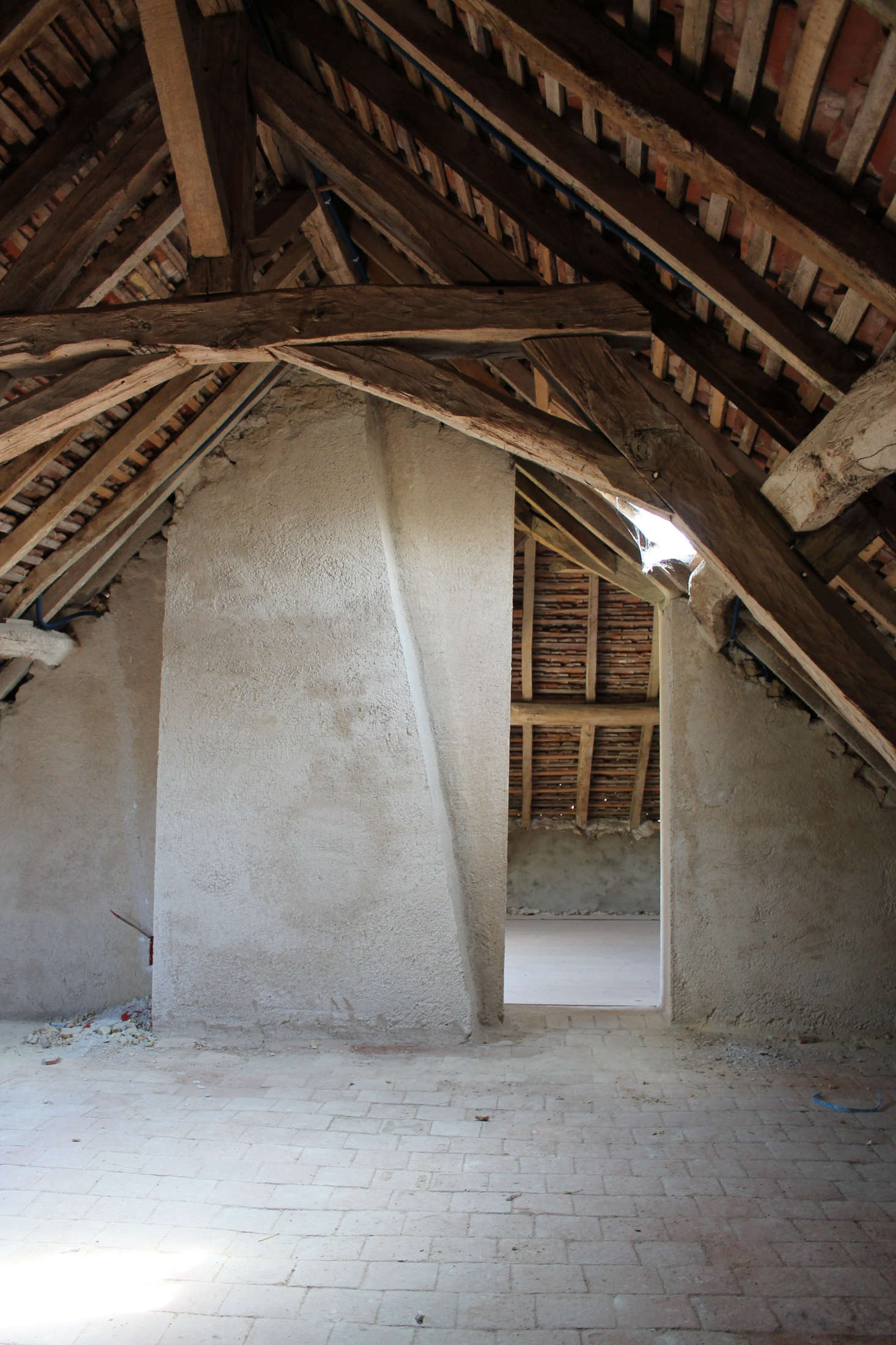 The original exposed beams and stone floor.