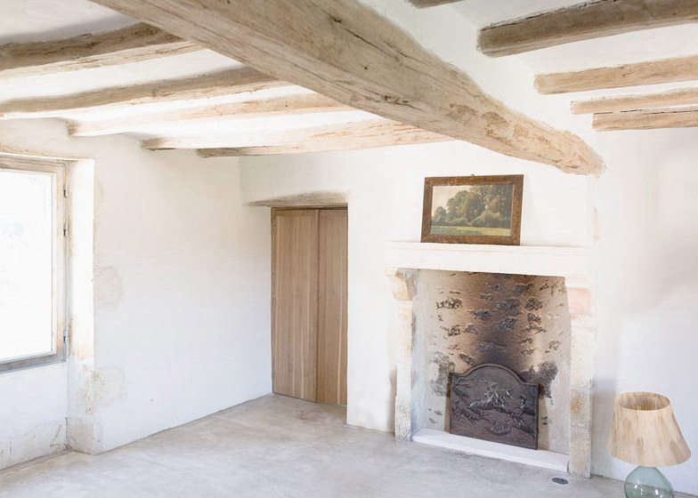 The original stone fireplace.The white walls in all the rooms form a backdrop to a palette of soft, natural shades.