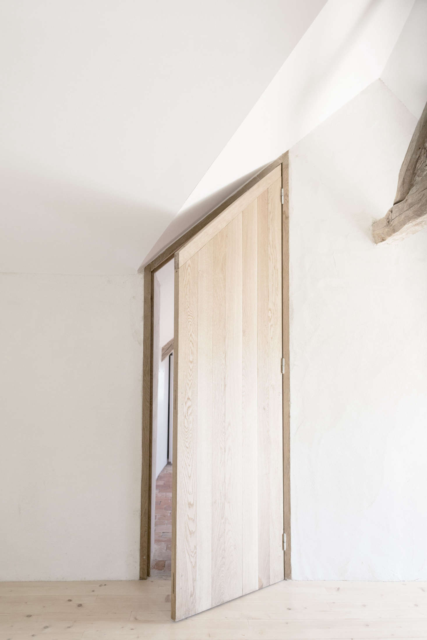 The silhouette of the door follows the roofline.