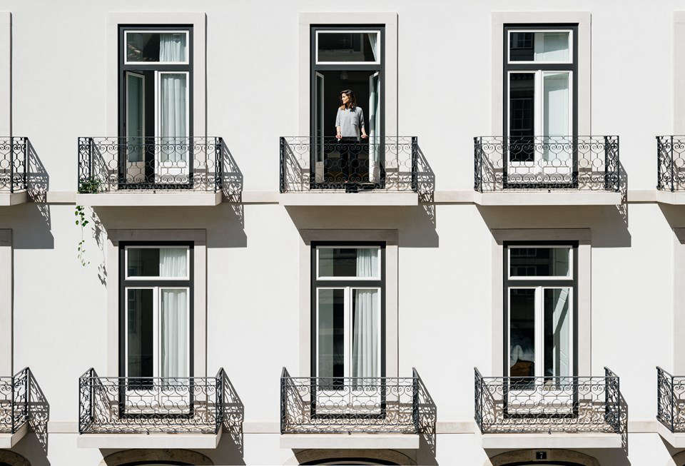 "Balconies look out onto Lisbon. ""She can give you a sense of belonging the moment you start exploring her streets,"" the hotel website tells us. ""Yes, Lisbon is a woman."""