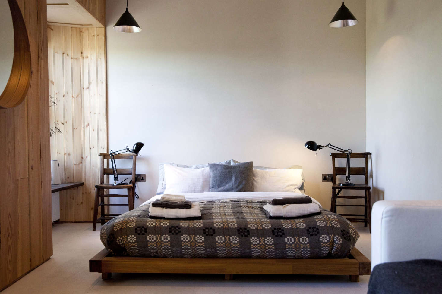Traditional wool blankets by iconic mill Melin Teifil covers the beds in FForest: A Former Farm Transformed into the Ultimate Welsh Country Retreat.