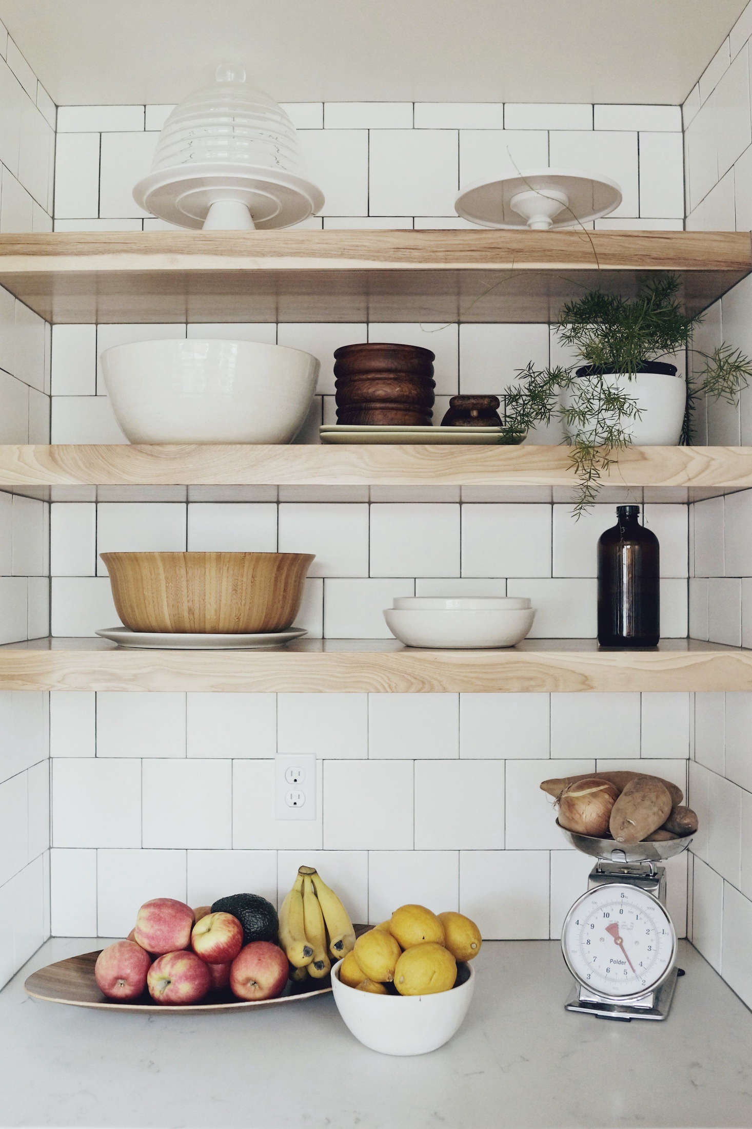 A Storage Niche With Hickory Wood Shelves By Baywood Cabinet Holds A Number  Of Objects From