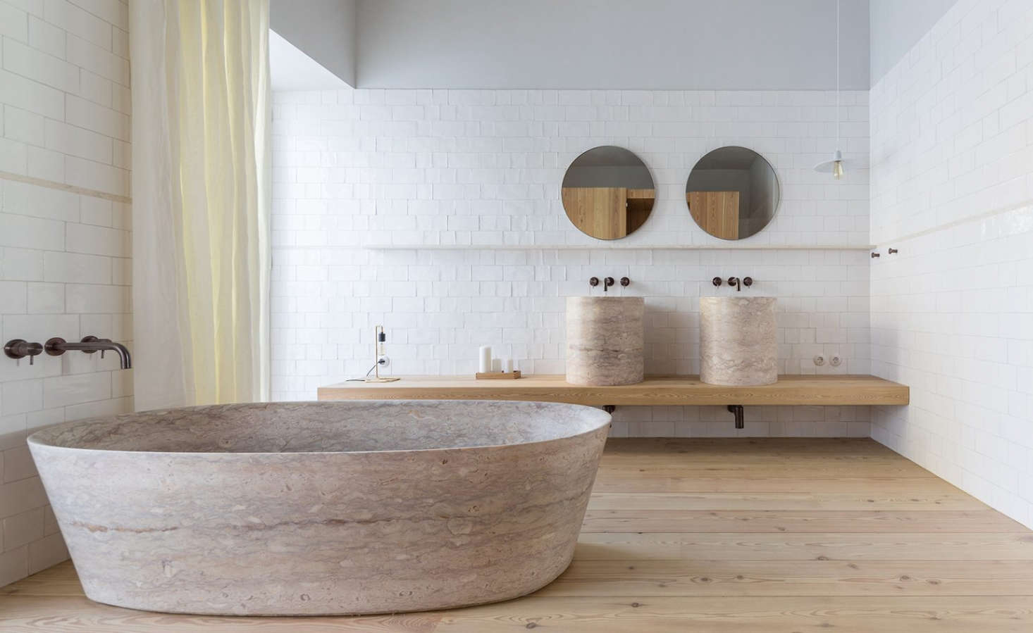 Bathrooms are generously sized, with pine wood floors and hand-cuttiles.