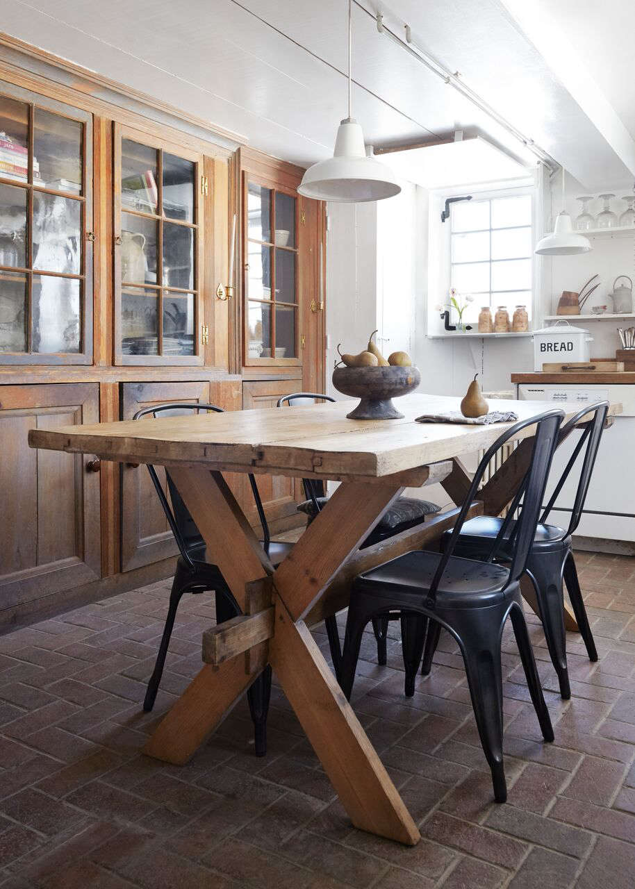 The kitchen is located in a 50s-era addition off the main house; the antique Swedish dining table is from Red Chair and the Tolix-style chairs are from Hammertown in Rhinebeck. &#8