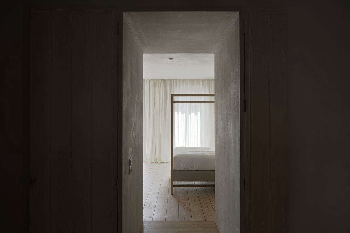 A view through the oak doorway into one of the hotel's six bedrooms.