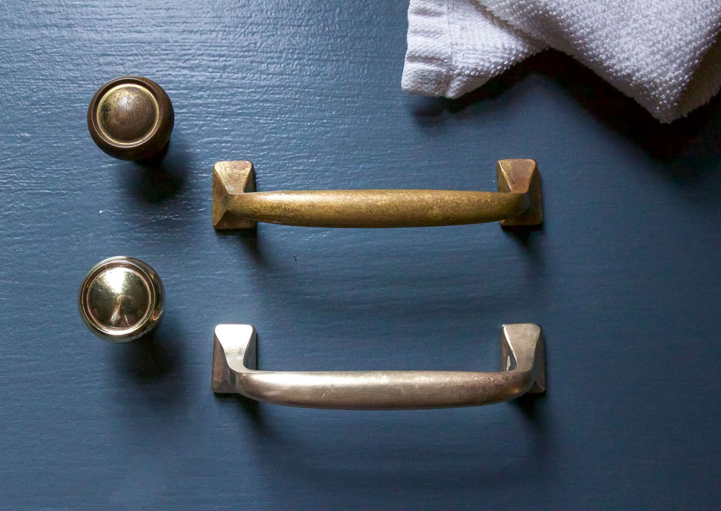 My brass hardware before and after. Note that the polished vintage handle has a soft, pleasingly matte finish, unlike the newer brasspiece.