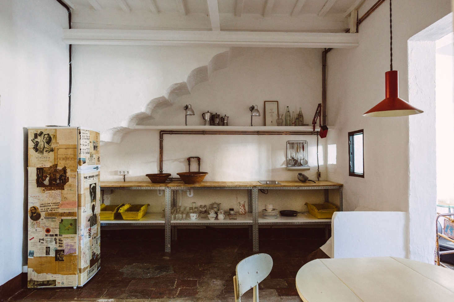 "The designers outfitted a top-floor guest apartment in the house with an industrial kitchenette built using copper piping and modular steel shelving. ""It's not a place for a lot of cooking, just some tea and an omelette,"" says Pols."