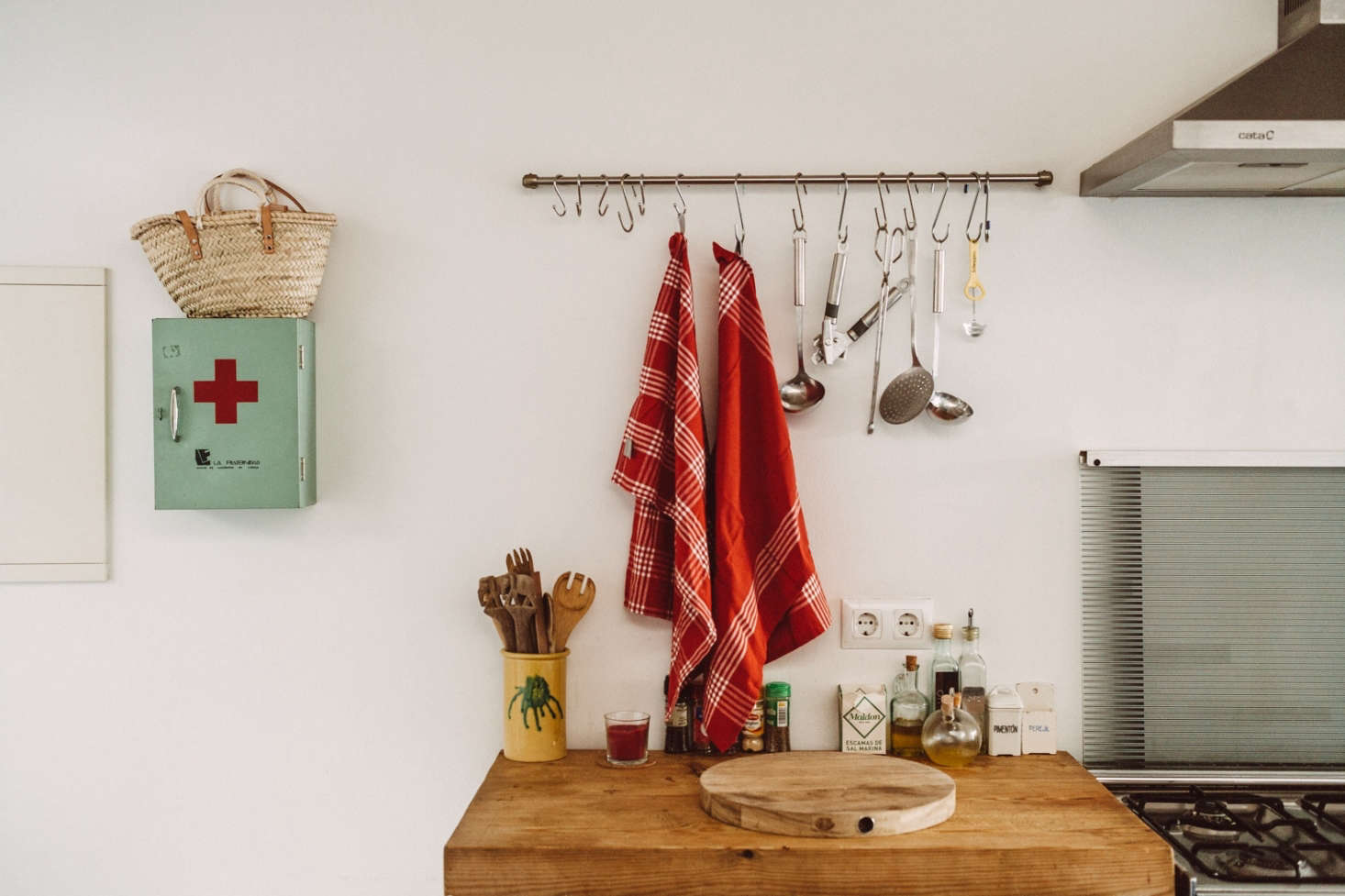 In a formerly kitchenless structure that Benito and Pol renovated for themselves, they hung an Ikea Grundtal Rail as a utensil rack over the chopping board.